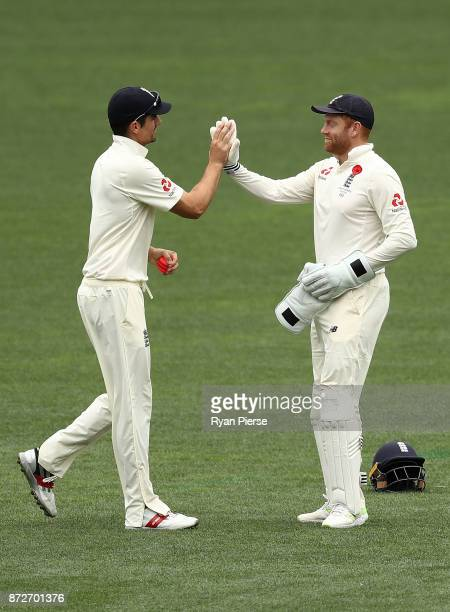 Alastair Cook and Jonny Bairstow of England celebrate victory during day four of the four day tour match between the Cricket Australia XI and England...