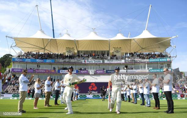 Alastair Cook and Keaton Jennings of England walk out to bat ahead of the Specsavers 4th Test match between England and India at The Ageas Bowl on...