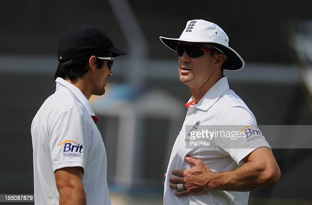 Alastair Cook captain of England and Kevin Petersen walk to field during the final day of the first practice match between England and India 'A' at...