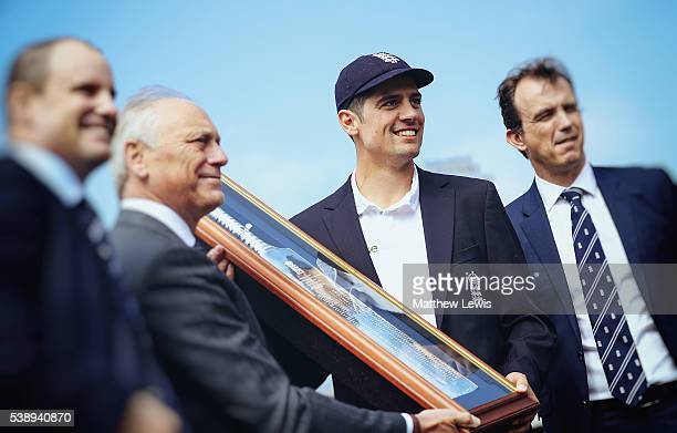 Alastair Cook captain of England is presented with a silver bat to commemorate his 10000 test runs by ECB director of cricket Andrew Strauss Chairman...