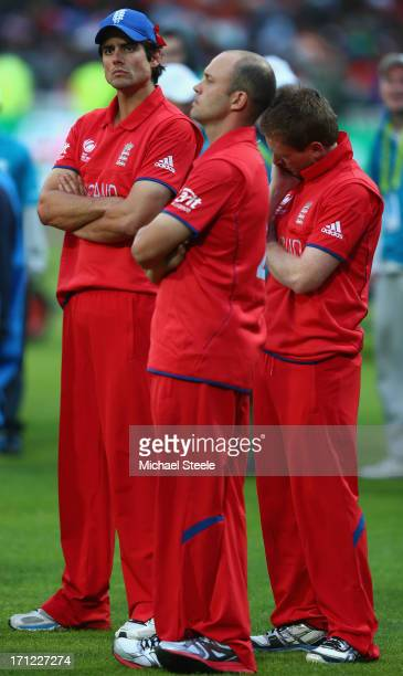 Alastair Cook captain of England looks on dejectedly during the trophy presentation alongside Jonathan Trott Eoin Morgan after their 5 run defeat to...