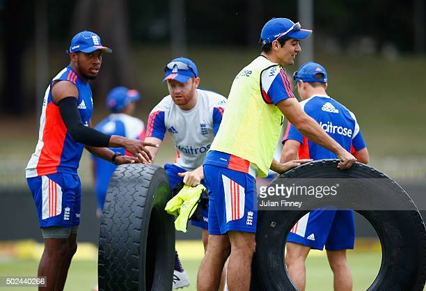 Alastair Cook Chris Jordan and Jonny Bairstow of England remove the tyres during England nets and training session at Sahara Stadium Kingsmead on...