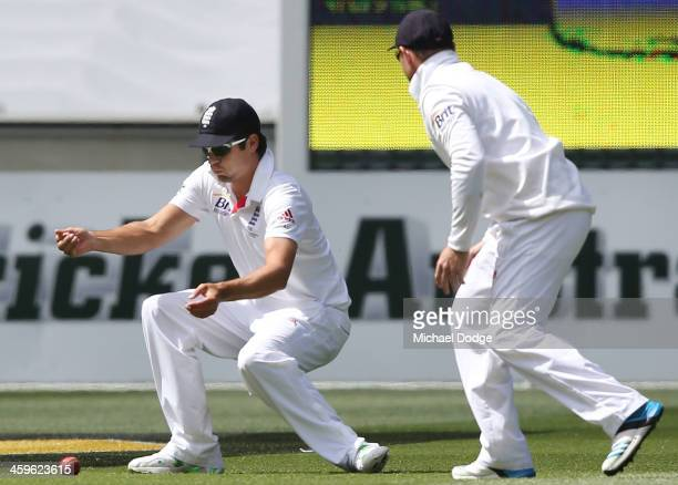 Alastair Cook drops the ball when fielding in slips during day four of the Fourth Ashes Test Match between Australia and England at Melbourne Cricket...