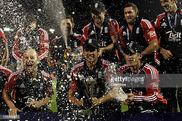 Alastair Cook of England and his team mates celebrate with champagne and the trophy following their series victory at the end of the 5th Natwest One...