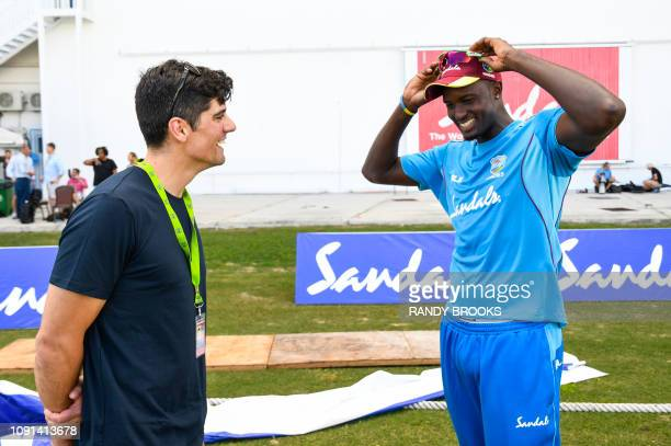 Alastair Cook of England and Jason Holder of West Indies chat during a training session one day ahead of the 2nd Test between West Indies and England...