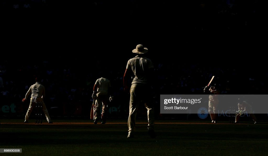 Alastair Cook (R) of England bats against the bowling of Steve Smith (L) of Australia in the final over of the day during day two of the Fourth Test Match in the 2017/18 Ashes series between Australia and England at Melbourne Cricket Ground on December 27, 2017 in Melbourne, Australia.