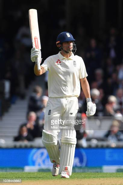 Alastair Cook of England celebrates after reaching his half century during the Specsavers 5th Test - Day One between England and India at The Kia...