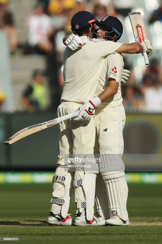 Alastair Cook of England celebrates making his century with Joe Root (R) during day two of the Fourth Test Match in the 2017/18 Ashes series between Australia and England at Melbourne Cricket Ground on December 27, 2017 in Melbourne, Australia.