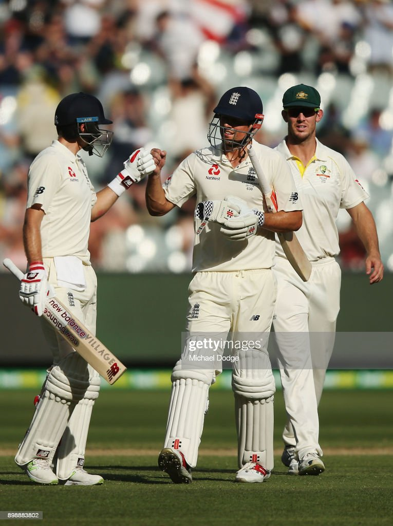 Alastair Cook of England celebrates making his century with Joe Root (L) during day two of the Fourth Test Match in the 2017/18 Ashes series between Australia and England at Melbourne Cricket Ground on December 27, 2017 in Melbourne, Australia.