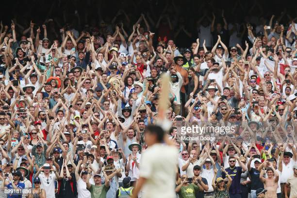 Alastair Cook of England celebrates making his double century in front of the Barmy Army during day three of the Fourth Test Match in the 2017/18...