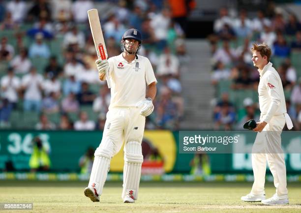 Alastair Cook of England celebrates reaching his century as Steve Smith of Australia looks on during day two of the Fourth Test Match in the 2017/18...