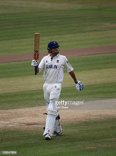 Alastair Cook of England celebrates reaching his century during the LV County Championship match between Essex and Yorkshire at the County Ground on...