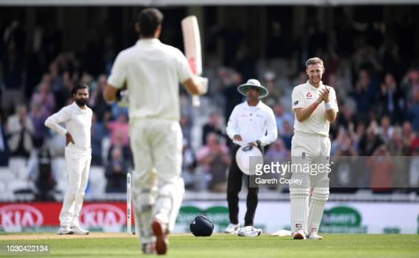 Alastair Cook of England celebrates reaching his century with captain Joe Root during day four of the Specsavers 5th Test match between England and...