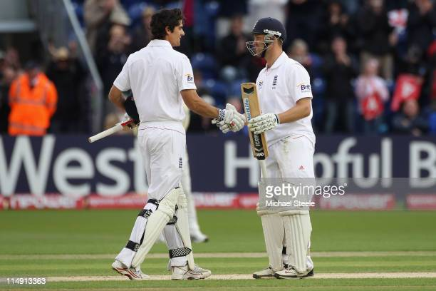 Alastair Cook of England celebrates reaching his century with Jonathan Trott during day three of the 1st npower test match between England and Sri...