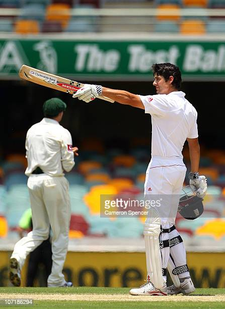 Alastair Cook of England celebrates scoring 200 runs during day five of the First Ashes Test match between Australia and England at The Gabba on...