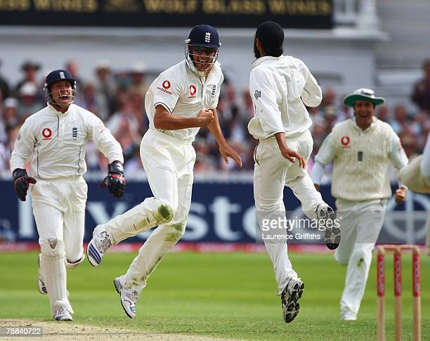Alastair Cook of England celebrates the catch to dismiss Dinesh Karthik of India with bowler Monty Panesar and wicketkeeper Matt Prior during day two...