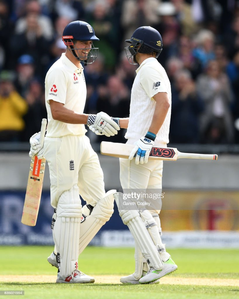 Alastair Cook of England celebrates with Dawid Malan after reaching his double century during day two of the 1st Investec Test match between England and West Indies at Edgbaston on August 18, 2017 in Birmingham, England.