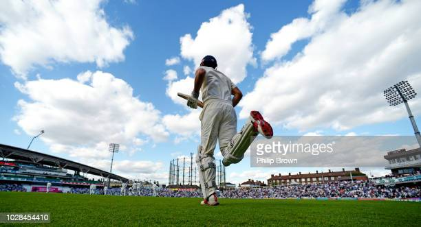 Alastair Cook of England comes out to bat after the tea break during the fifth Specsavers Test Match between England and India at The Kia Oval on...