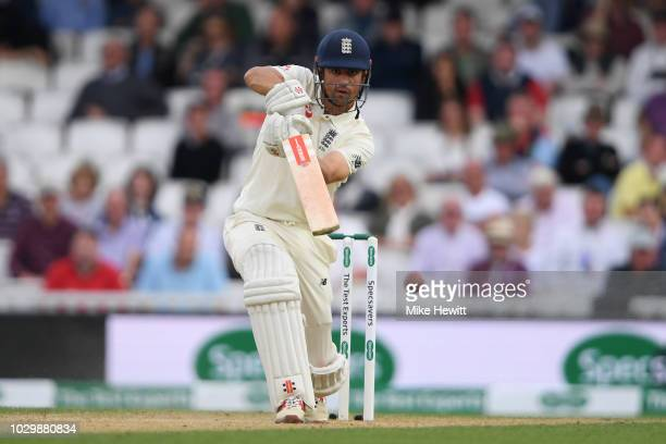Alastair Cook of England drives during the Specsavers 5th Test Day Three between England and India at The Kia Oval on September 9 2018 in London...
