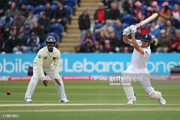 Alastair Cook of England drives to the offside as Tharanga Paranavitana looks on during day three of the 1st npower test match between England and...