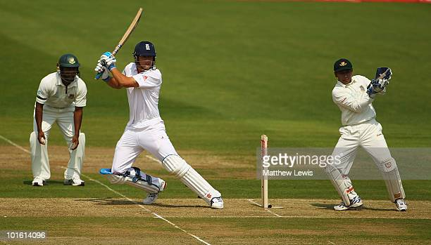 Alastair Cook of England edges the ball away towards the boundary as Mushfiqur Rahim of Bangladesh looks on during the first day of the 2nd npower...