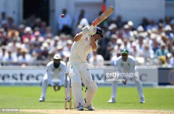 Alastair Cook of England fends at a bouncer from Chris Morris of South Afrrica which is caught out by Quinton de Kock during day four of the 2nd...