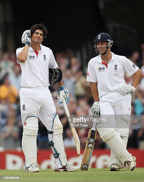 Alastair Cook of England gestures after reaching his century with Jonathan Trott during day three of the npower 3rd Test Match between England and...