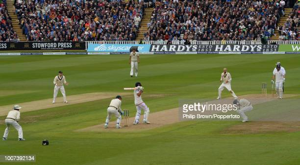Alastair Cook of England is caught off the bowling of Nathan Lyon of Australia by Adam Voges at short leg during the 3rd Ashes Test match between...