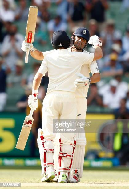 Alastair Cook of England is congratulated by Joe Root as he celebrates reaching his century during day two of the Fourth Test Match in the 2017/18...
