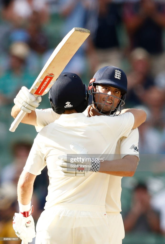 Alastair Cook of England is congratulated by Joe Root as he celebrates reaching his century during day two of the Fourth Test Match in the 2017/18 Ashes series between Australia and England at Melbourne Cricket Ground on December 27, 2017 in Melbourne, Australia.