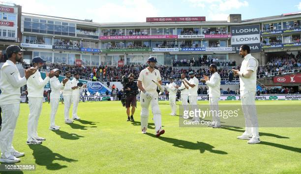 Alastair Cook of England is given a guard of honour as he walks out to bat during day one of the Specsavers 5th Test between England and India at The...