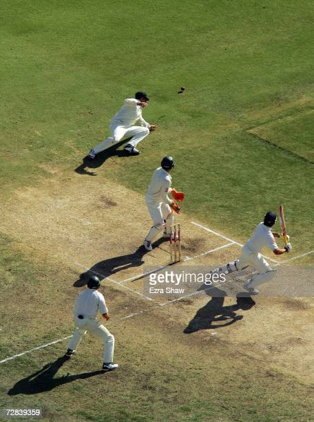 Alastair Cook of England late cuts a delivery from Shane Warne of Australia past Matthew Hayden of Australia during day four of the third Ashes Test...