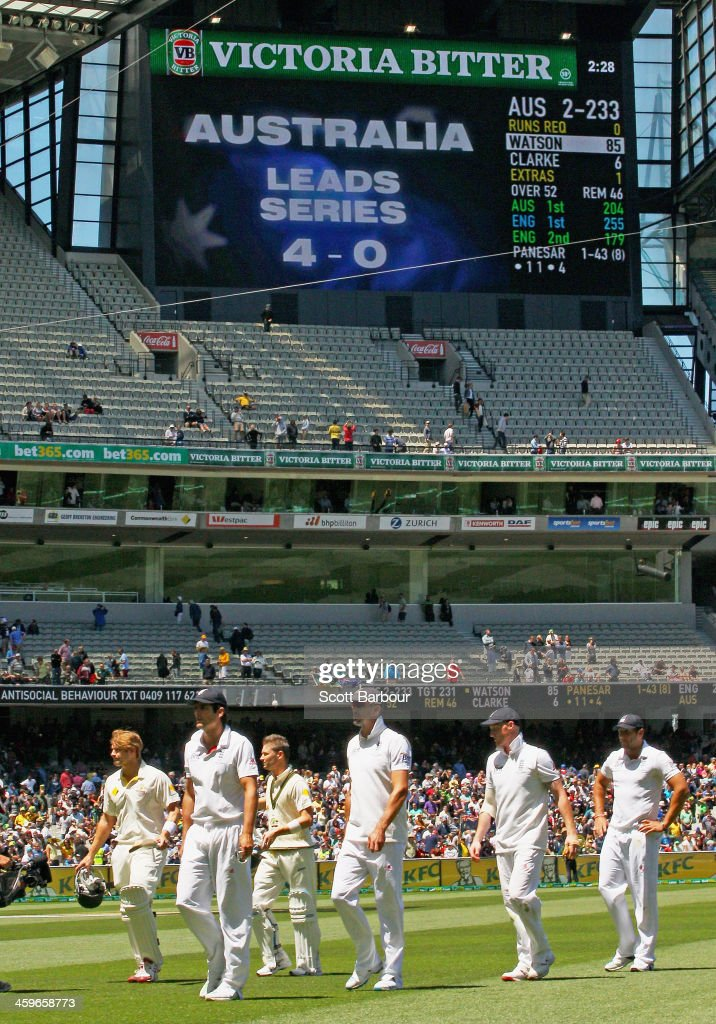 Alastair Cook of England leads his team from the field after losing during day four of the Fourth Ashes Test Match between Australia and England at Melbourne Cricket Ground on December 29, 2013 in Melbourne, Australia.