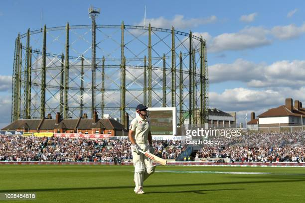 Alastair Cook of England leaves the field after being bowled by Jasprit Bumrah of India during day one of the Specsavers 5th Test between England and...