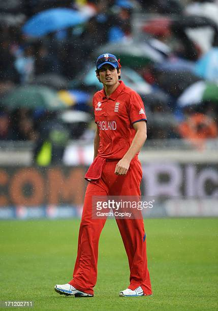 Alastair Cook of England leaves the field as rain falls during the ICC Champions Trophy Final between England and India at Edgbaston on June 23 2013...