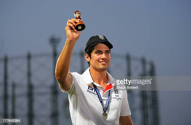Alastair Cook of England lifts the urn after winning the Ashes during day five of the 5th Investec Ashes Test match between England and Australia at...