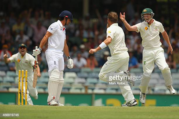 Alastair Cook of England looks dejected after being bowled by Ryan Harris of Australia during day four of the Third Ashes Test Match between...