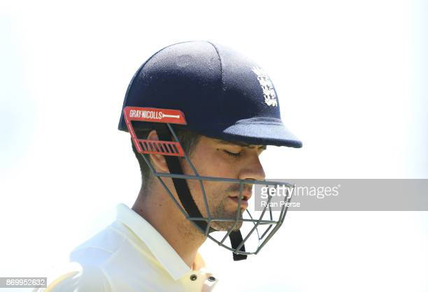 Alastair Cook of England looks dejected after being dismissed by Nathan CoulterNile of Western Australia XI during day one of the Ashes series Tour...