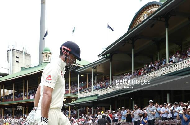 Alastair Cook of England looks dejected after being dismissed by Nathan Lyon of Australia during day four of the Fifth Test match in the 2017/18...