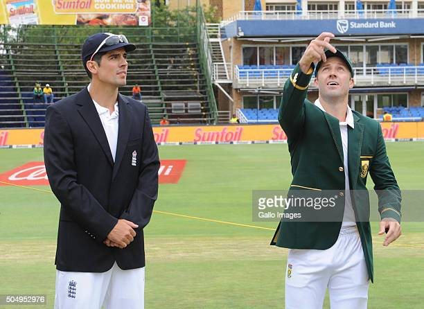 Alastair Cook of England looks on as AB de Villiers of South Africa tosses the coin during day 1 of the 3rd Test match between South Africa and...