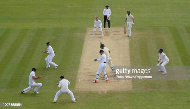 Alastair Cook of England parries the ball off the bat of Mitchell Starc of Australia off thebowling of Joe Root before Adam Lyth completes the catch...