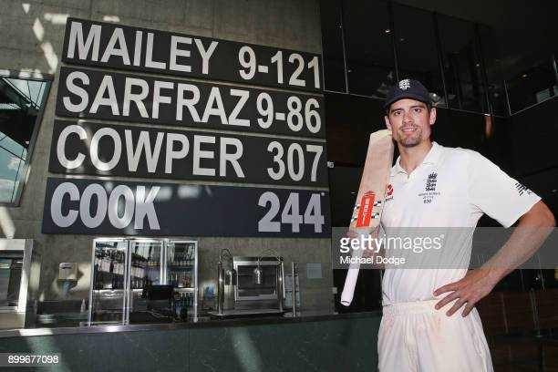 Alastair Cook of England poses next to his score of 244 not out made in the Percy Beams bar after the drawn result during day one of the Fourth Test...