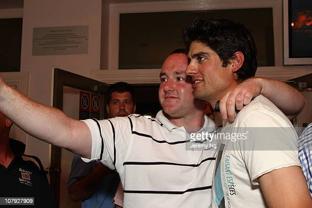 Alastair Cook of England poses with a fan at the Retro Hotel in the early hours of January 8 2011 in Sydney Australia The English cricket team...