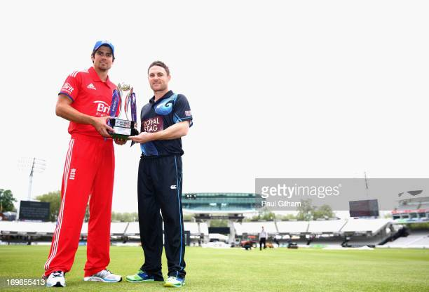 Alastair Cook of England poses with Brendon McCullum of New Zealand and the Natwest One Day Series Trophy during an England nets session ahead of the...