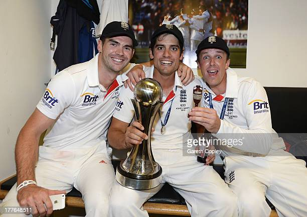 Alastair Cook of England poses with James Anderson and Graeme Swann in the dressing room after winning the Ashes during day five of the 5th Investec...