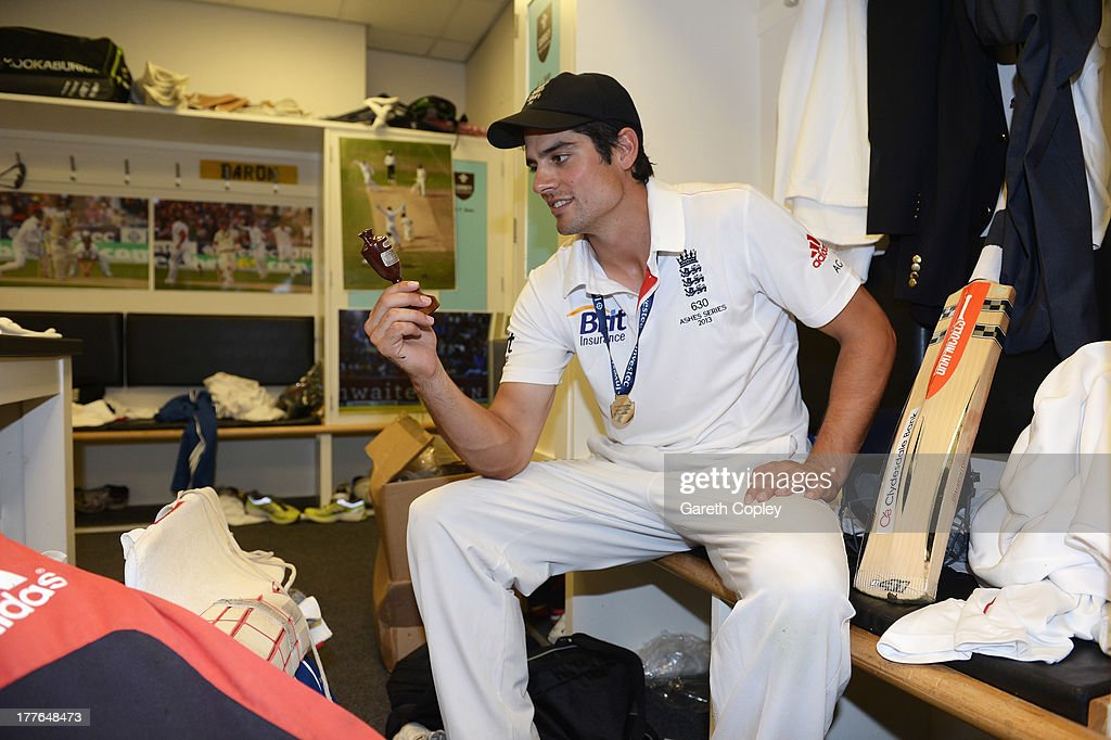 Alastair Cook of England poses with the urn in the dressing room after winning the Ashes during day five of the 5th Investec Ashes Test match between England and Australia at the Kia Oval on August 25, 2013 in London, England.