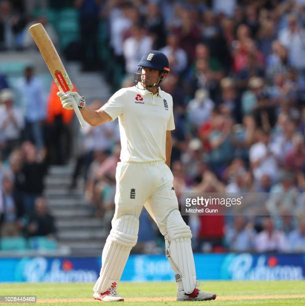 Alastair Cook of England raises his bat and celebrates scoring a half century during day one of the 5th Specsavers test match between England and...