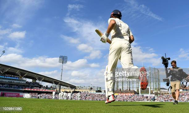 Alastair Cook of England runs out for his final test innings during day three of the Specsavers 5th Test match between England and India at The Kia...