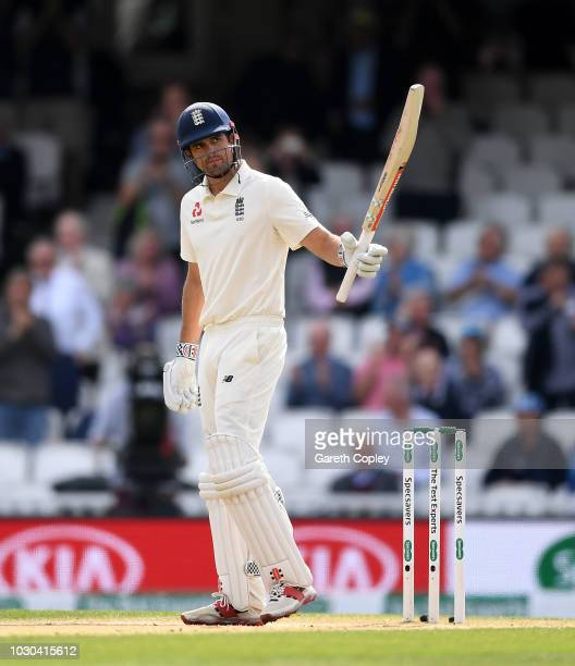 Alastair Cook of England salutes the crowd after reaching his half century during day four of the Specsavers 5th Test match between England and India...