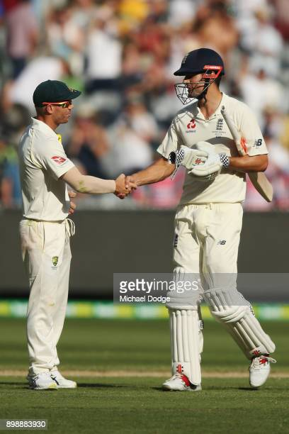 Alastair Cook of England shakes hands with David Warner of Australia after making his century during day two of the Fourth Test Match in the 2017/18...